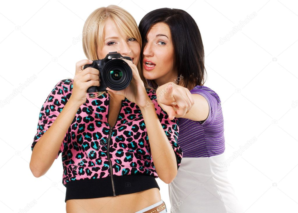 Two lovely friends with a camera, white background   Stock Photo #5726293