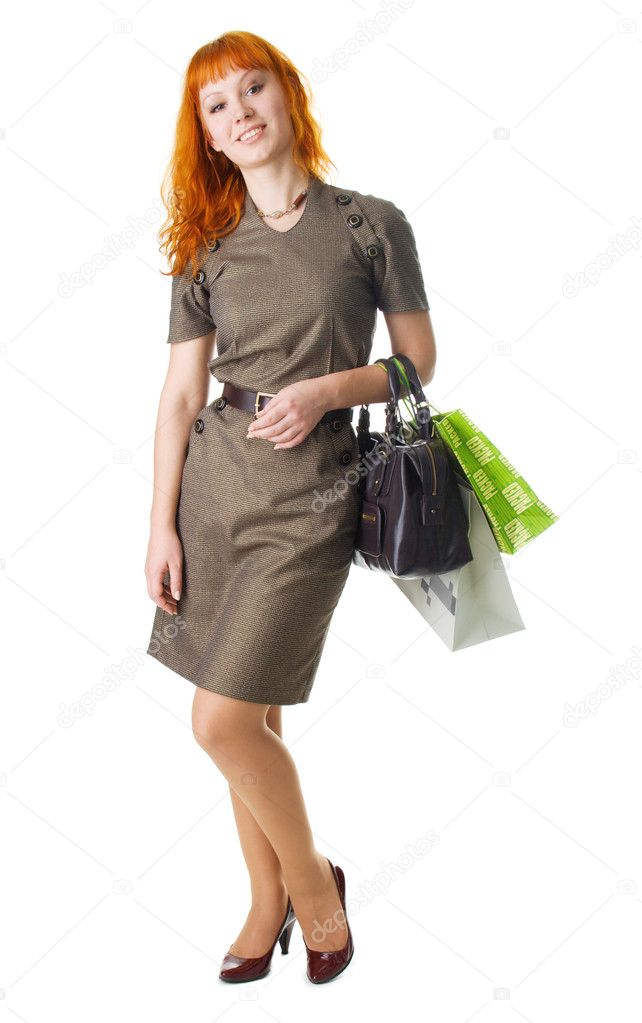 Beautifulyoung woman with shopping bags, full length portrait  Stock Photo #5726700