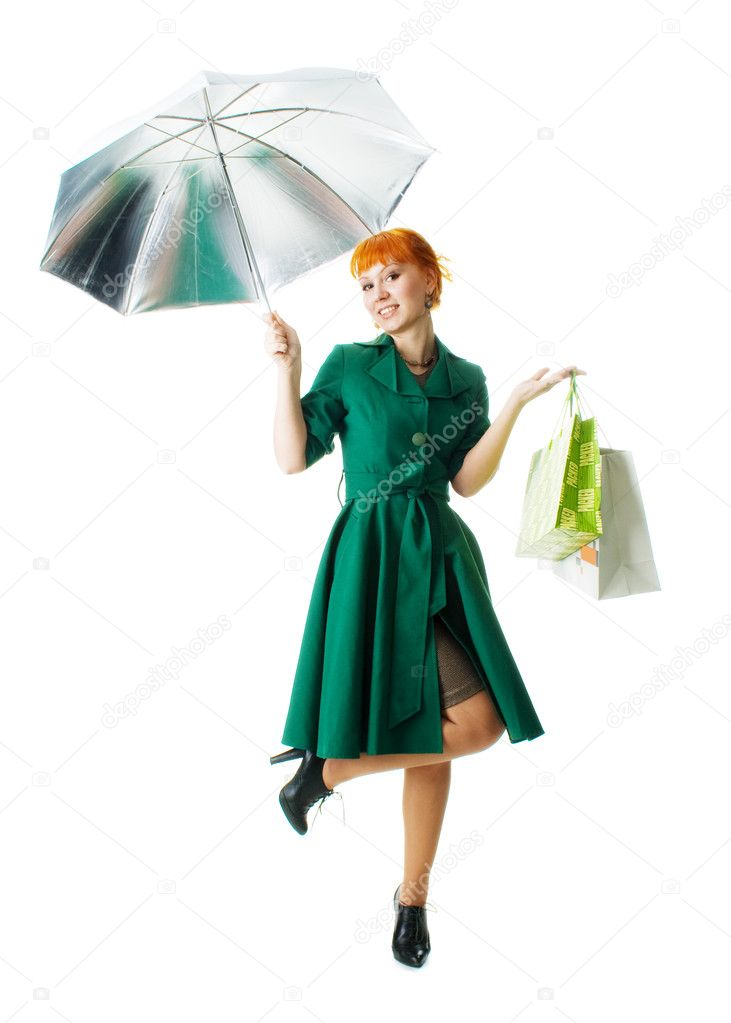 Beautiful lady with an umbrella and shopping bags — Stock Photo #5726713