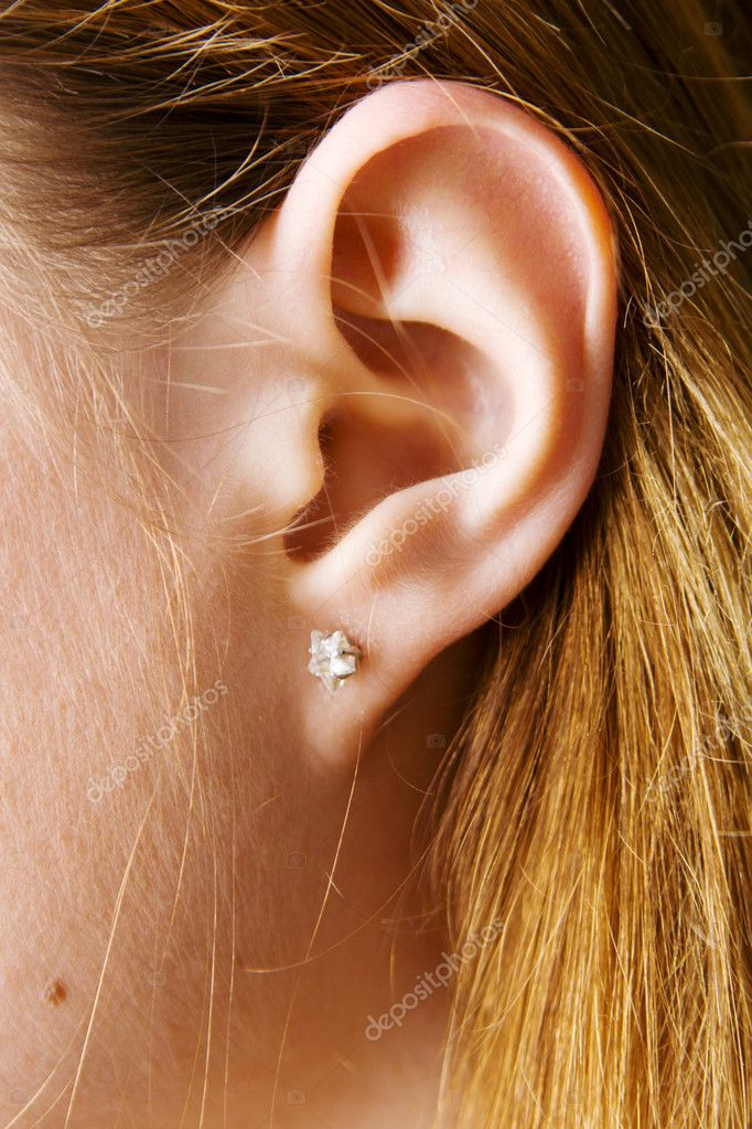 Closeup photo of a pretty female ear — Foto Stock #5727244