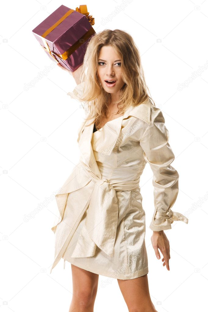 Furious woman throwing a gift box, white background — Stock Photo #5727480