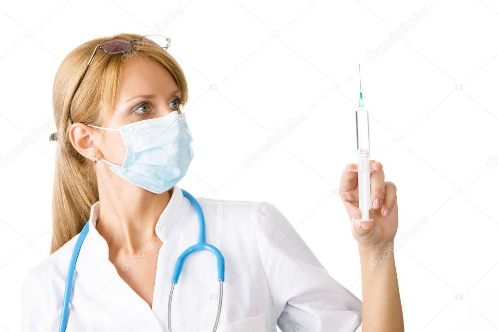Young professional doctor holding a syringe — Stock Photo #5727757