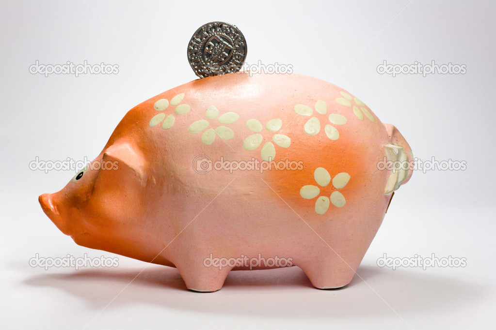 Ruddy piggy bank made of clay isolated on white background  Stock Photo #5729096