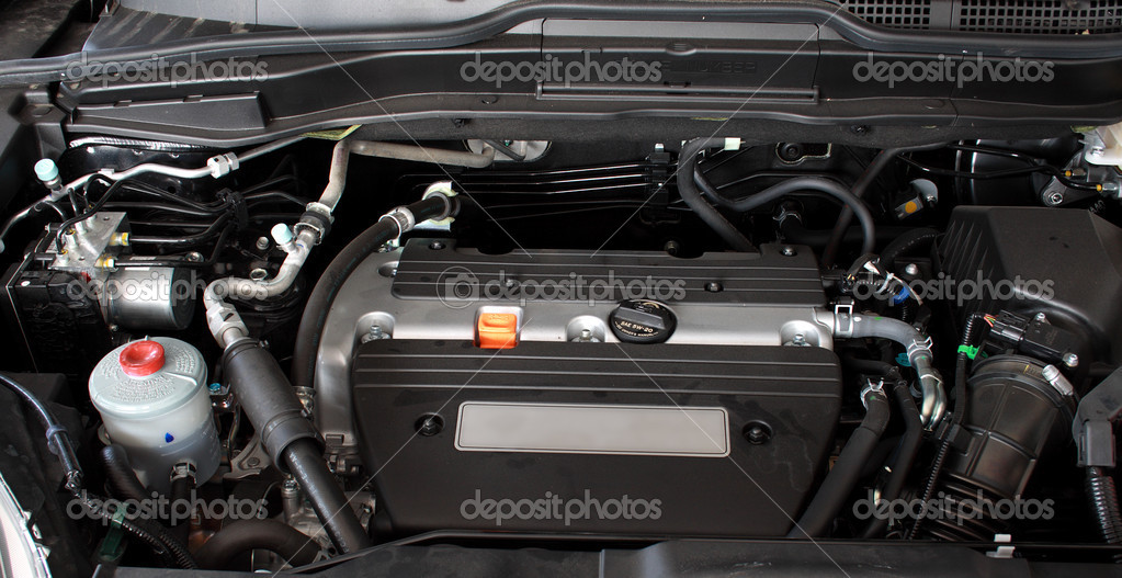 Open engine of a modern car — Stock Photo #5729597
