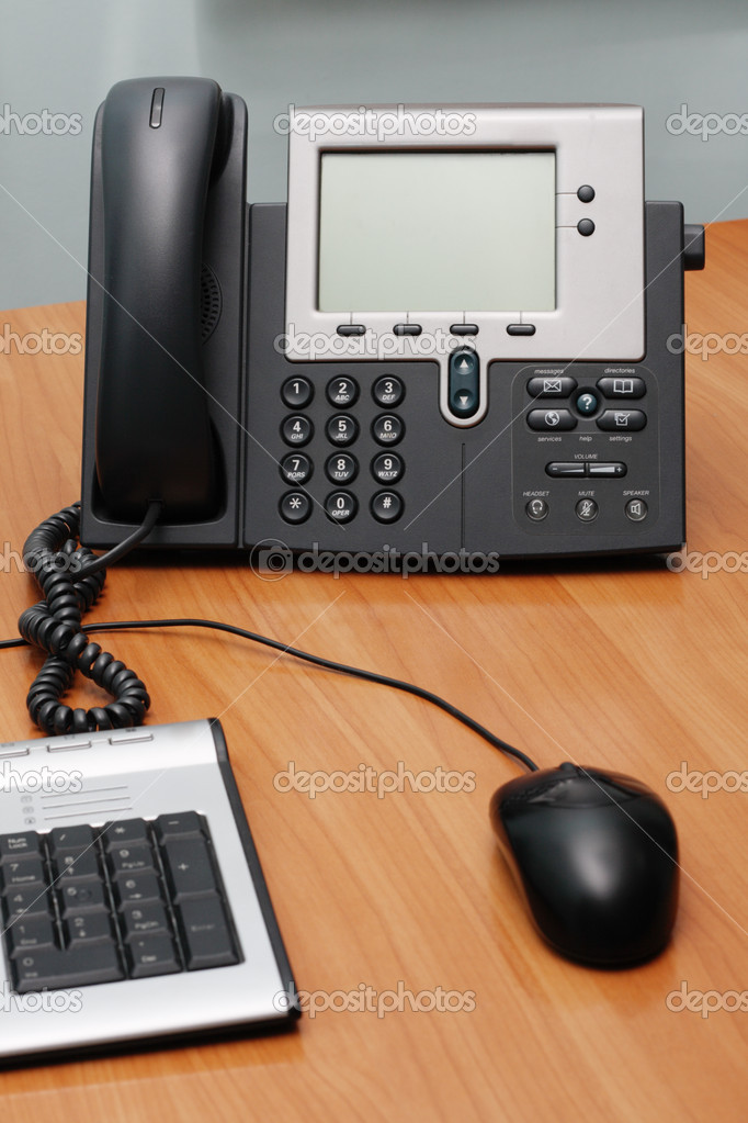 Modern digital phone on office table — Stock Photo #5729702