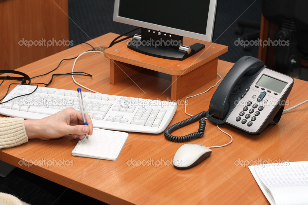 Desktop with a computer and an IP Phone on it — Stock Photo #5729938