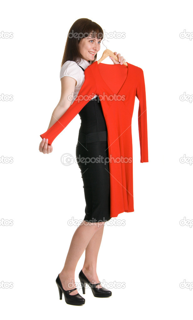 Beautiful lady trying on a red dress — Stock Photo #5729975