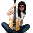 Pretty young girl holding an electric guitar — Stock Photo