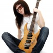 Pretty young girl holding an electric guitar - Stock Photo