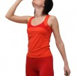 Woman in sports outfit drinking water — Stock Photo