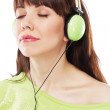 Beautiful girl with green headphones — Stock Photo