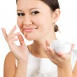 Young beautiful woman applying skin cream — Stock Photo #5730064