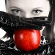 Gorgeous woman holding a red apple — Stock Photo