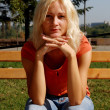 Beautiful girl in a park, looking at camera — Stock Photo #5730156