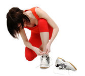 Woman tightening her jogging shoes — Stock Photo