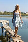 Girl walking along the pier — Stock Photo