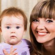 Foto Stock: Happy mother with cute little daughter