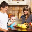 Happy family at the time of breakfast — Stock Photo