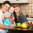 Happy young family at home — 图库照片