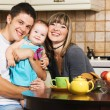 Happy young family at home — Stockfoto