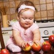 Cute infant girl playing at kitchen - Stock Photo
