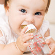 Cute baby drinking water — Stock Photo