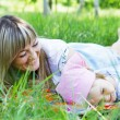 Mother with daughter outdoors — Stock Photo #5757919