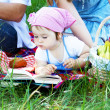 Young family of three on a picnic — Stock Photo #5757921