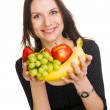 Beautiful young woman with a bunch of fruits — Stok fotoğraf