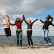 Girls having fun at the beach — Stock Photo