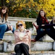 Girls sitting in a park — Stock Photo #5758004