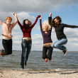 Stock Photo: Girls having fun on the river shore