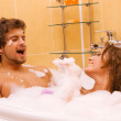 Beautiful young couple enjoying a bath — Stock Photo #5758045