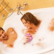 Beautiful young couple in a bath — Stock Photo