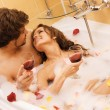Beautiful young couple enjoying a bath - Stock Photo