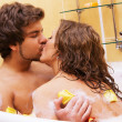 Photo: Beautiful young couple enjoying a bath