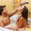 Beautiful young couple enjoying a bath — Стоковое фото