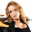 Pretty girl with electric guitar — Stock Photo #5758076