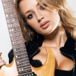 Sexy girl with electric guitar — Stock Photo #5758080