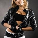 Beautiful woman in black leather jacket — Stock Photo #5758085