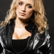Beautiful sexy woman in black leather jacket - Stok fotoraf