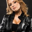 Beautiful woman in black leather jacket — Stock Photo #5758093