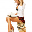 Sexy student girl with a stack of books — Stock Photo
