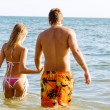 Young beautiful couple at the seaside — Stock Photo #5758214