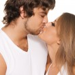 Beautiful young couple kissing — Stock Photo #5758238