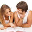 Stock Photo: Young couple reading a book
