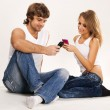 Beautiful couple with mobile phones — Stock Photo