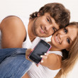 Stock Photo: Beautiful couple with a mobile phone