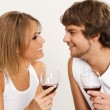 Cheerful young couple drinking wine — Stock Photo #5758307