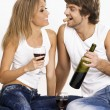 Cheerful young couple drinking wine — Stock Photo #5758311